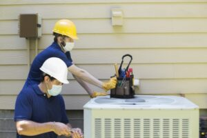 technicians-working-on-outside-ac-unit