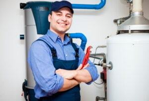 technician-working-on-water-heater